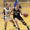 Record-Eagle/Jan-Michael Stump<br /> Glen Lake's Scotlyn Brengman (14) tries to drive past Traverse City St. Francis' Lauren Buckel (20) in the second half of Wednesday's game.