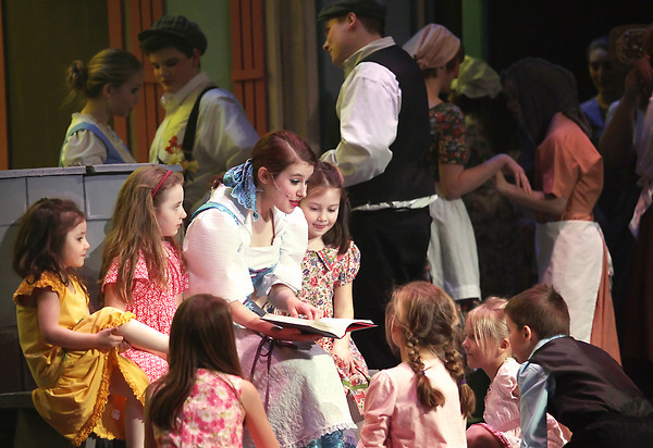 Record-Eagle/Keith King<br /> Hannah Gauthier, playing the part of Belle, performs in a scene Wednesday, February, 27, 2013 during a dress rehearsal for Beauty and the Beast at Traverse City West High School. The show, presented by the Traverse City West High School Music Department, is scheduled to begin March 1.