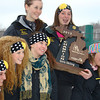 Record-Eagle/Dennis Chase<br /> Traverse City Central senior Paige Pfannenstiel holds the state championship trophy after the trojans title-clinching effort Monday at Boyne Mountain. Shannon Weaver, left of Pfannenstiel, finished second in slalom and giant slalom to lead the Trojans to the Division 1 crown.