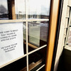Record-Eagle/Keith King<br /> A note is displayed in a door at TraVino Traverse Wine & Grille Tuesday, February 26, 2013 in Acme Township.