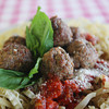 Record-Eagle/Keith King<br /> Homemade meatballs made the traditional Italian way lie on homemade fettucini, house red sauce, imported Reggiano parmesan cheese (aged 24 months) and basil Wednesday, February, 27, 2013 at Folgarelli's Market and Wine Shop in Traverse City.
