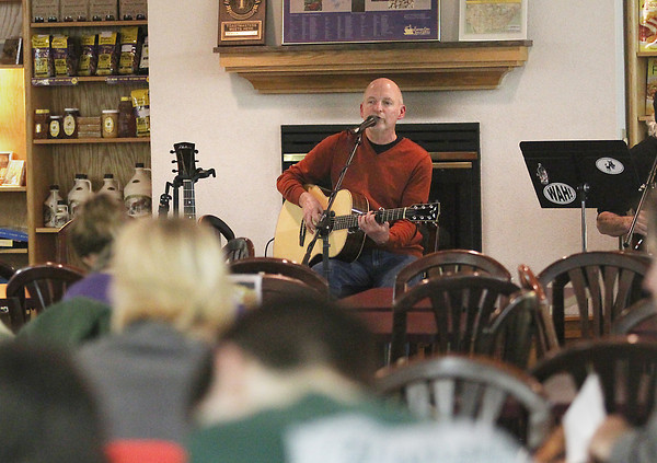 Record-Eagle/Keith King<br /> Kurt Bullock, a member of Songwriters in the Round, performs Friday, February 15, 2013 at the Horizon Shine Cafe in the lower level of Horizon Books in Traverse City.