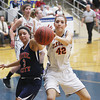 Record-Eagle/Keith King<br /> Boyne City's Latiesha Bell (3) and Elk Rapids' Bridget Granger (42) hustle for the ball Wednesday, February, 27, 2013 at Traverse City St. Francis High School.