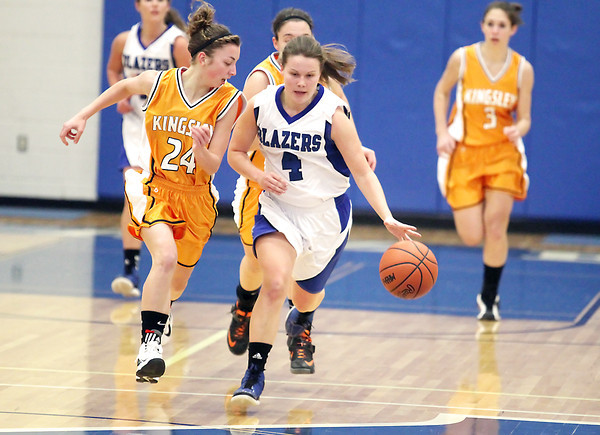 Record-Eagle/Keith King<br /> <br /> Kalkaska's Kelli Guy (4) dribbles the ball against Kingsley's Sarah Lueck (24) Tuesday, January 15, 2013 at Kalkaska High School.