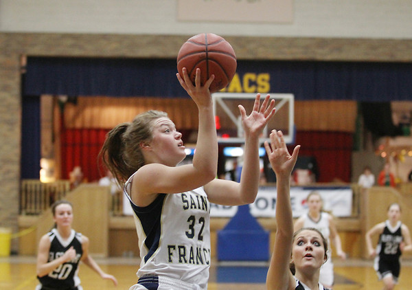 Record-Eagle/Keith King<br /> Traverse City St. Francis' Liza Erickson (32) puts up a shot against Glen Lake Wednesday, February, 27, 2013 at Traverse City St. Francis High School.