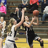 Record-Eagle/Jan-Michael Stump<br /> Glen Lake's Scotlyn Brengman (14) drives past Traverse City St. Francis' Bridget Bussell (42) in the first half of Wednesday's game.