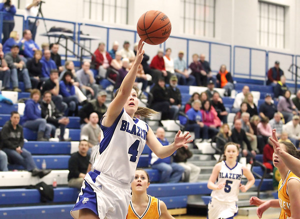Record-Eagle/Keith King<br /> <br /> Kalkaska's Kelli Guy (4) shoots the ball against Kingsley Tuesday, January 15, 2013 at Kalkaska High School.