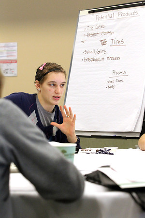 """Record-Eagle/Jan-Michael Stump<br /> Lake Leelanau St. Mary's Rachael Thon discusses product ideas with her group during Wednesday's Junior Achievement of Northwest Michigan Youth Summit for Entrepreneurs. 70 students from 15 high schools in six counties attended the event at the Hagerty Center in Northwestern Michigan College's Great Lakes Campus, where, in groups, they were challenged to repurpose a current item of their choice and develop business and marketing plans to present to judges. The winning team each received a """"money tree"""" with $100 on it."""
