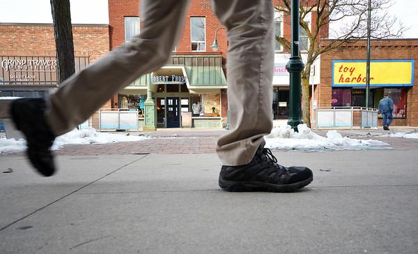 Record-Eagle/Dan Nielsen<br /> Pedestrians walk along Front Street.