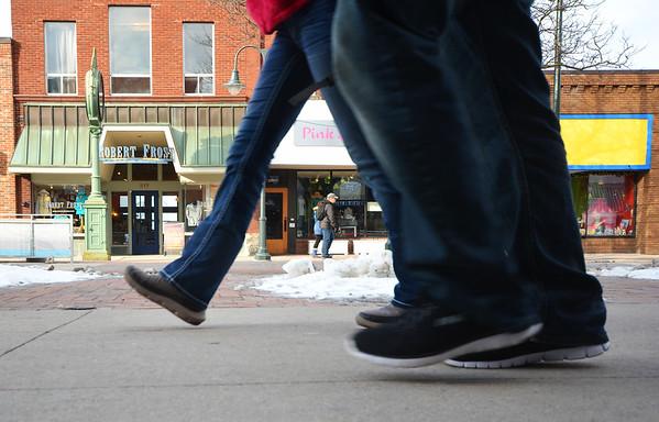 Record-Eagle/Dan Nielsen<br /> <br /> Pedestrians walk along Front Street.