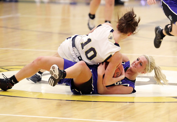Record-Eagle/Keith King<br /> Kalkaska's Chelsea Matley, bottom, battles against Traverse City St. Francis' Cassie Williams for possession of the basketball Wednesday, March 2, 2011 at Glen Lake High School. Kalkaska won 49-37.