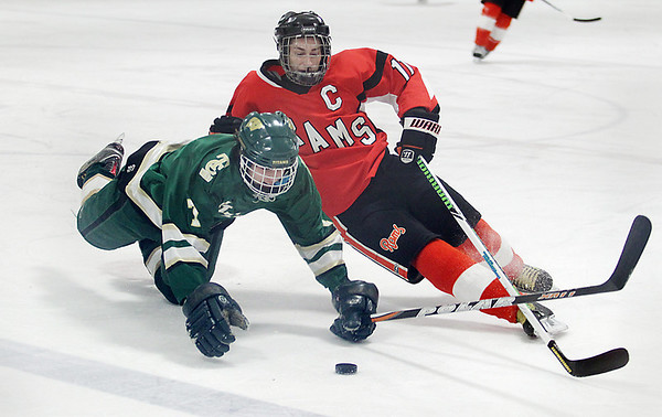Record-Eagle/Keith King<br /> Traverse City West's Collin Peters, left, and Rockford's Zachary Vandawater go down while battling for control of the puck Thursday, March 3, 2011 in Howe Arena at the Grand Traverse County Civic Center.