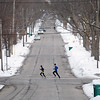 Record-Eagle/Keith King<br /> Runners travel along North Madison Street in Traverse City.