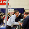 Record-Eagle/Jan-Michael Stump<br /> Ken McCardel, left, of McCardel Culligan, talks with Denise and Mark Bair, of Benzonia, at the 2011 Home Builders Expo Saturday at Traverse City East Middle School. The event is open from 11 a.m. to 4 p.m. on Sunday.