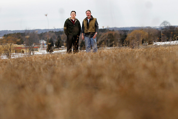 "Record-Eagle/Jan-Michael Stump<br /> Rob Evina, left, and Dan Kelly both own businesses near the future site of an Acme development along M-72 that includes a Meijer store, and are frustrated with the time it's taking to get the project started. ""Just get it going, it's a good project,"" said Kelly."