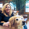 Record-Eagle/Jan-Michael Stump<br /> Susan Reabe, here with her dogs Cricket and Cody, founded the non-profit organization Helping Owners with Pet Expenses. The organization provides pet food and medical-bill assistance to pet owners in need as an option against giving up their pets.