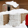 Record-Eagle/Jan-Michael Stump<br /> Snow falling from a rooftop knocked over and damaged several port-a-potties near the finish of the 20k and 10k races during the 35th annual White Pine Stampede.