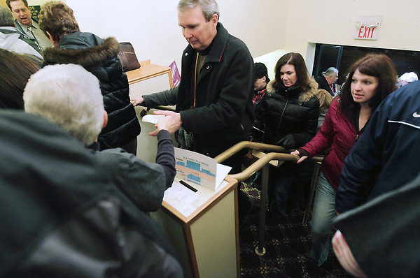 """Record-Eagle/Keith King <br /> Attendees show their tickets to see Michael Moore and his """"Dancing With the Stars"""" act Friday at the Old Town Playhouse."""