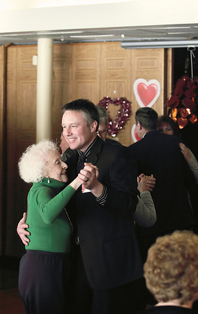 Record-Eagle/Keith King <br /> Jonathan Leeds dances with Helen Allen, both of Traverse City, on Friday during the Valentine's Tea Dance, presented by the Traverse City Senior Center, at the Traverse City Elks Club. Leeds was with EZ Able, LLC, a sponsor of the event.