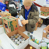 Record-Eagle/Keith King<br /> Norm Bamberg, left, Father Fred Foundation operations director, and Jim McAndrews, volunteer, sort food Monday at Garfield Centre in Traverse City during the 20th annual Father Fred Foundation Frostbite Food Drive in Traverse City. The event is scheduled to take place through Sunday.