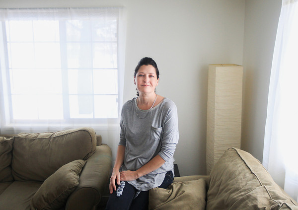 Record-Eagle/Keith King<br /> Sarah Hammond, of Traverse City, sits Wednesday in her home.