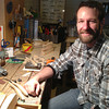 Record-Eagle/Nathan Payne<br /> Brian Irwin sits in his basement carving shop where he creates ice fishing decoys with the same methods used for generations in northern Michigan.