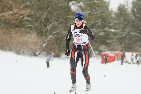 Record-Eagle/Keith King<br /> Marquette's Abby Potts nears the finish line in the girls 1K classic sprint finals during the Michigan High School Nordic Ski State Championship at the Vasa Pathway in Acme Township.