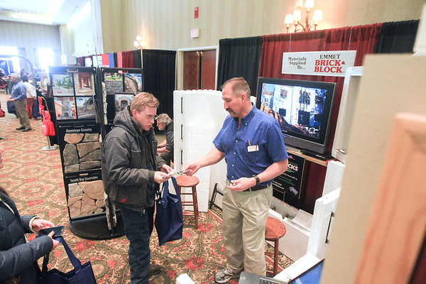 Record-Eagle/Keith King<br /> Mike Perpich, left, of Fife Lake, talks with Jim LeJeune, with Emmet Brick and Block, during the Grand Traverse Area Home Builders Association 2014 Home Expo at the Grand Traverse Resort and Spa in Acme Township.