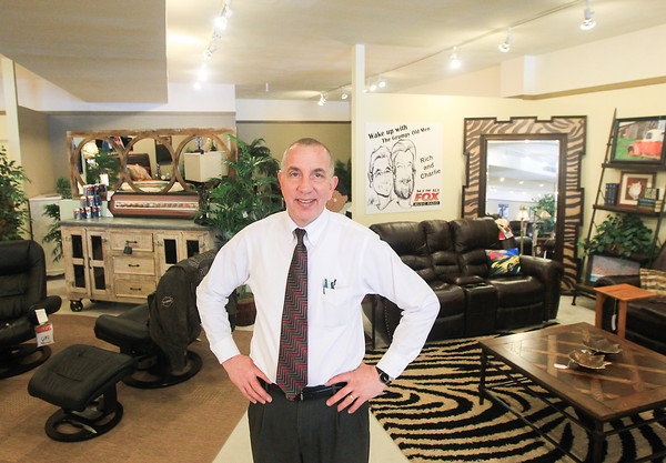 """Record-Eagle/Keith King<br /> Mike Mahn, owner and general manager, stands in Golden-Fowler Home Furnishings near the """"Grumpy Old Men"""" display which is for the Celebrity DreamRoom Classic scheduled for February 14."""