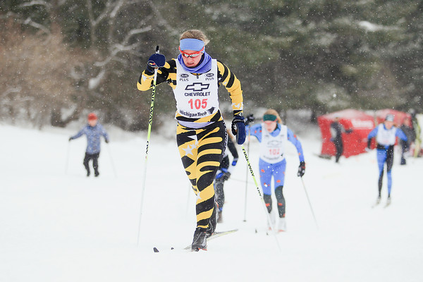Record-Eagle/Keith King<br /> Traverse City Central's Erin Lipp nears the finish line in the girls 1K classic sprint finals during the Michigan High School Nordic Ski State Championship at the Vasa Pathway in Acme Township.