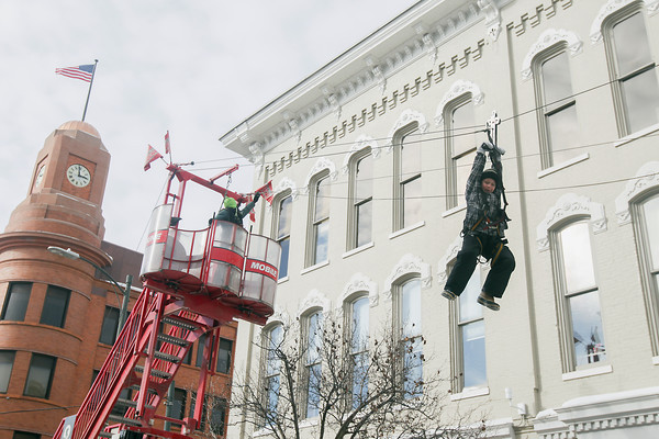 Record-Eagle/Keith King<br /> Peter Hetzel, 9, of Traverse City, rides the zip line on Front Street during the Traverse City Winter Comedy Arts Festival.