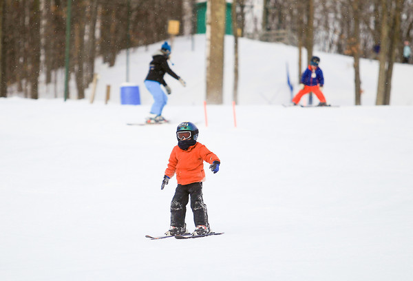 Record-Eagle/Keith King<br /> Miles Kirkwood, 5, of Traverse City, and a student in a Grand Traverse Ski Club clinic, skis down a hill Friday at Hickory Hills Ski Area in Traverse City.