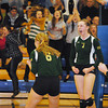 Record-Eagle/James Cook<br /> Traverse City West junior Katie Placek (7) celebrates a point as teammates Kelsey Boudjalis (6) and Maggie Gray (9) look on in Tuesday's five-game Class A state quarterfinal at Midland.