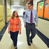 "Record-Eagle/Allison Batdorff<br /> Robyn Hentschel, 12, walked the hallway with Steven Urbanski, East Middle School Principal. Hentschel supports a new Michigan law requiring schools to make time for the ""Pledge of Allegiance"" in the school day. Urbanski is proud of Hentschel for speaking to her teacher about it during the policy's instatement."