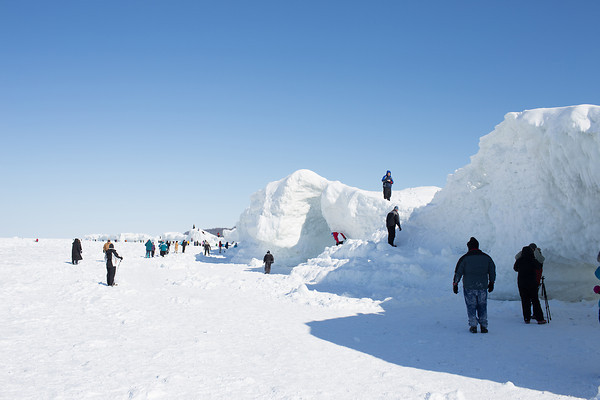 Record-Eagle/Keith King<br /> People gather Sunday at ice caves and formations north of Leland on Lake Michigan.