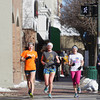 Record-Eagle/Keith King<br /> Graceanne Tarsa, from left, 16, Zoe Gerstle, 16 and Molly Peregrine, 17, run through downtown Traverse City past melting snow as they train for the Traverse City Central High School girls track team.