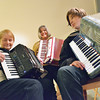 Record-Eagle/Allison Batdorff<br /> Pat VanDeventer, left, demonstrated a lesson on the accordion for students Mary Ransom, center, and Jack Capper, right. The 5,000-year-old instrument is experiencing a resurgence in popularity, said VanDeventer, who gives lessons out of her Traverse City home.