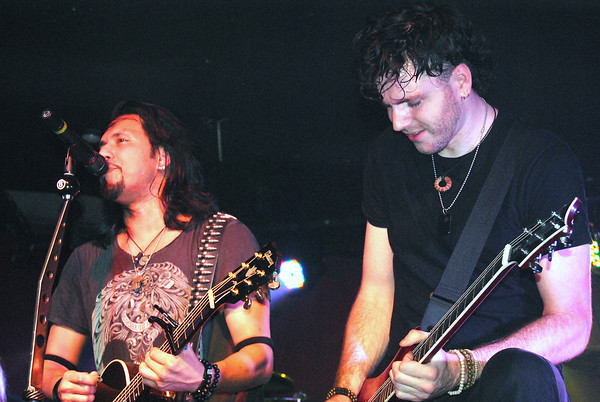 Record-Eagle/James Cook<br /> Pop Evil singer Leigh Kakaty and guitarist Nick Fuelling perform at Streeters Ground Zero in March 2013.