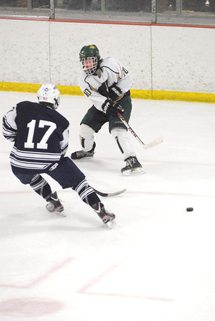 Record-Eagle/James Cook<br /> Traverse City West's Ryan Roehler (10) passes around Sault Ste. Marie's Zach Lasley (17) Thursday at Howe Arena. The Soo won 5-1.