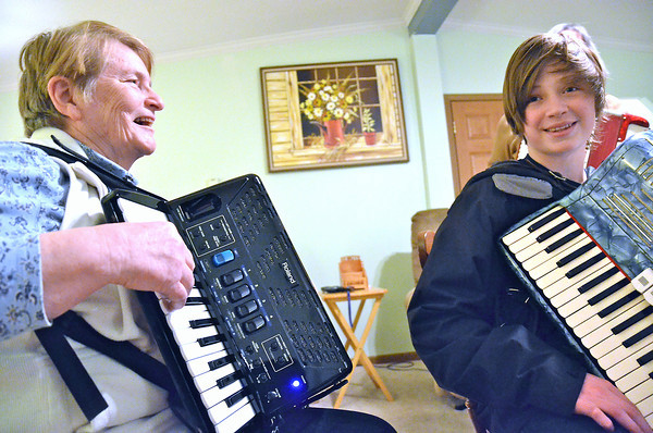 """Record-Eagle/Allison Batdorff<br /> Playing the accordion is all about """"expression,"""" said Pat VenDeventer, left, and most of the time, an accordion adds a toe-tapping liveliness to any music style. Jack Capper, 13, right, picked up the accordion this year because he likes the sound of it and he can play the instrument with his grandfather."""