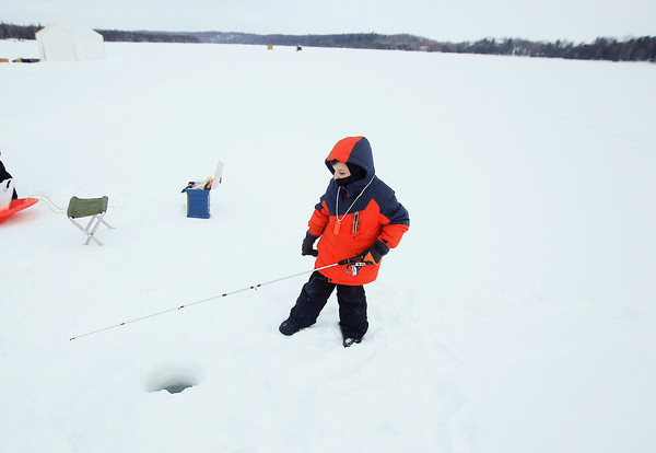 Record-Eagle/Keith King<br /> Kasey Ames, 6, of Leelanau County, ice fishes on Cedar Lake during the Elmwood Township Sesquicentennial Kids Ice Fishing Tournament which was put on by Elmwood Township and the Grand Traverse Area Sport Fishing Association.