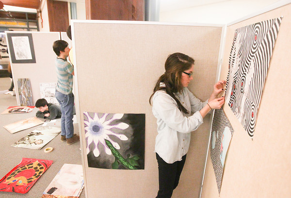 Record-Eagle/Keith King<br /> Jane Leahy, 16, along with classmates in Advanced Placement Studio Art, displays her art Wednesday at Traverse City Central High School for ArtPrize Central.