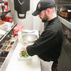 Record-Eagle/Keith King<br /> Christopher Love, executive chef at 7 Monks, makes a house salad.