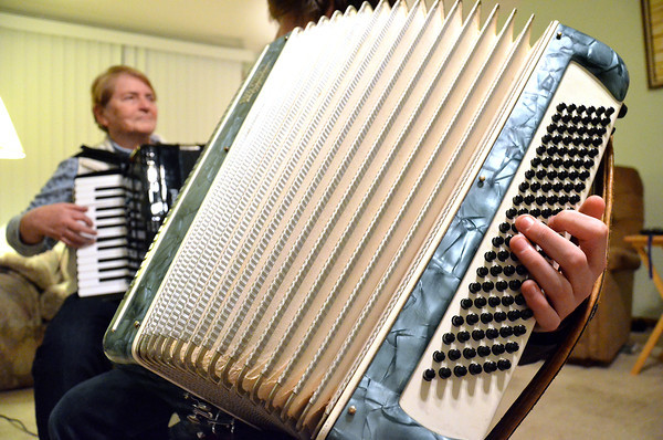 Record-Eagle/Allison Batdorff<br /> Standard accordions feature 120 bass buttons for chords, a keyboard and a bellows connecting the two boxes. Jack Capper found his traditional accordion online. Teacher Pat VanDeventer, background, invested in a smaller, electronic model.