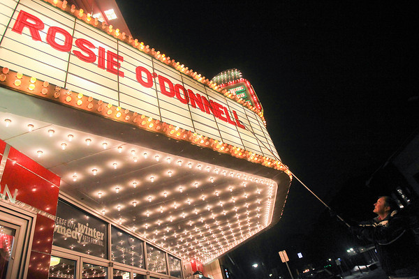 "Record-Eagle/Keith King<br /> Alan Collard, building manager, places letters on the State Theatre marquee to spell the name ""Rosie O'Donnell"" who is scheduled to perform at the State Theatre Thursday as part of the Traverse City Winter Comedy Arts Festival."