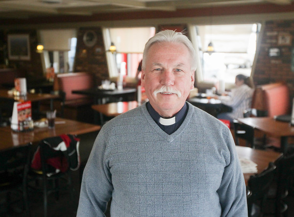 Record-Eagle/Keith King<br /> Daniel LeCouteur, senior pastor at Family of Faith Lutheran Church, stands Thursday at Pizza Hut in Traverse City where the Many Rooms program came to fruition.