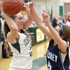 Record-Eagle/Keith King<br /> Traverse City West's Jessica Kalbfleisch (10) is defended by Petoskey's Liz Fraser (5) Thursday, February 7, 2013 at Traverse City West High School.