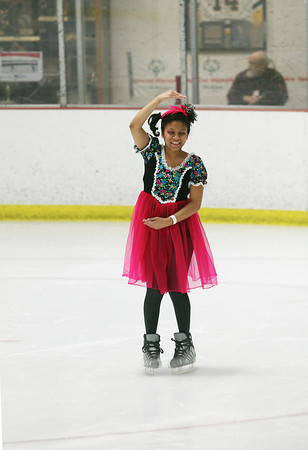 Record-Eagle/Jan-Michael Stump<br /> Desiray Cooper (cq) of Area 8 performs her figure skating routine at the Special Olympics Michigan Winter Games Thursday at Howe Arena.