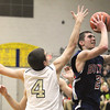 Record-Eagle/Jan-Michael Stump<br /> Boyne City's Corey Redman (2) shoots over Traverse City St. Francis' Ian Spencer (4) in the third quarter of Tuesday's game.