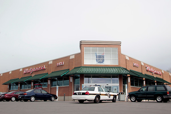 Record-Eagle/Jan-Michael Stump<br /> A Grand Traverse Sheriff's Deputy's car sits outside the Walgreens at 3900 N. U.S. 31 South, which was robbed Tuesday around 3 p.m.